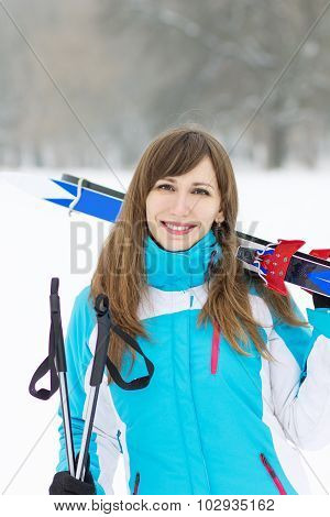 Cheerful Smiling Young Woman With Skis And Poles
