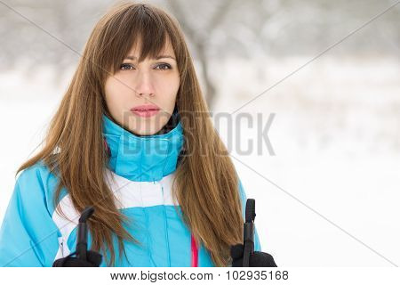 Young Woman Skiing At Winter Outdoor.