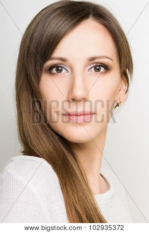 Beautiful Confident Young Woman Looking Straight Into A Camera