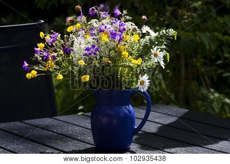 flowers in a blue jug