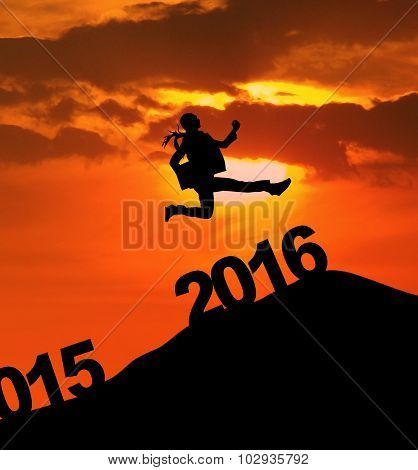 Excited Woman Jumps Over 2016 Numbers