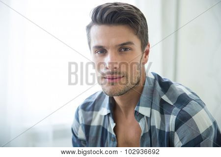 Portrait of a handsome man looking at camera