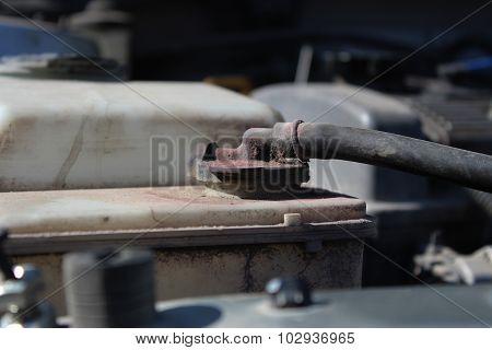 Dirty reservoir cap engine coolant car