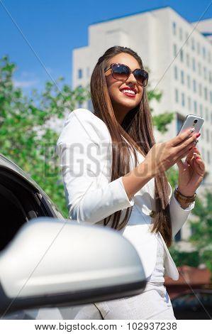 Business woman talking on smart phone