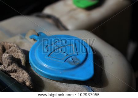 The Lid Of The Washer Fluid Reservoir From The Engine Of A Car