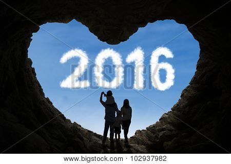 Happy Family Inside Cave Looking At Numbers 2016