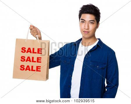 Man hold with shopping bag and showing three sale words