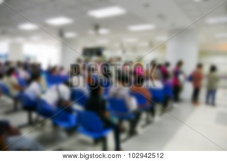 Blurry Defocused Image Of People Waiting To See Doctor In The Hospital