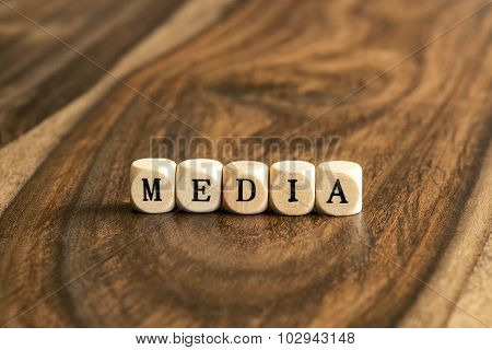 Word Media On Wooden Cubes