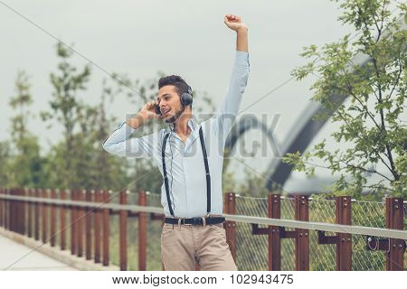 Young Handsome Man Listening To Music In An Urban Context
