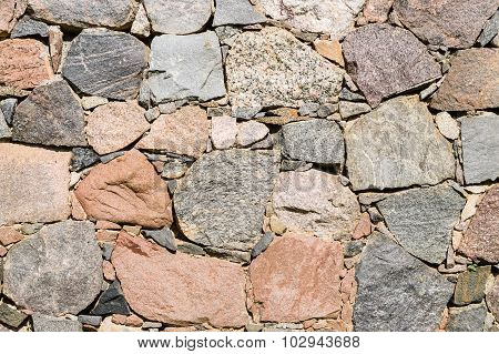 Texture Of Old Stone Wall Of Large Rough Boulders