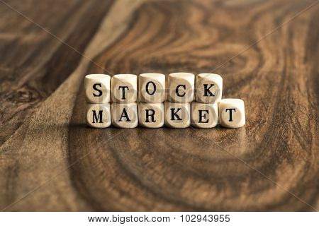 Word Stock Market On Wooden Cubes