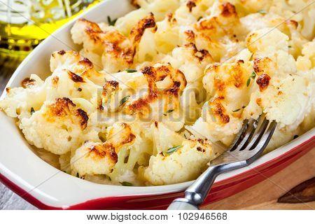 Cauliflower And Cheese Gratin In The Baking Dish Closeup