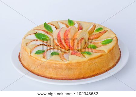 charlotte with apples and mint isolated on white background baked dessert
