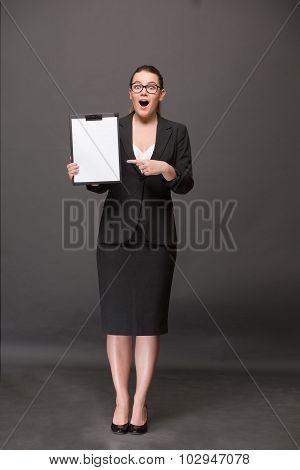 Businesswoman holding a clip board
