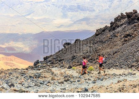 Unidentified people runs from the top of El Teide Volcano Tenerife Spain