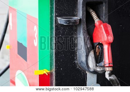 red refueling hose at petrol gas station