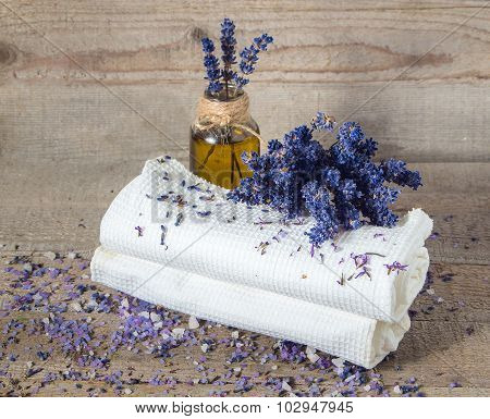 Lavender Oil, Lavender Flowers And Bath White Towels .