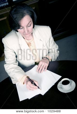 Business Woman Working In Her Office