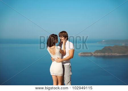 Passionate Couple In Love Over Sea And Blue Sky Background. Enjoyment. Holidays, Vacation, Love And
