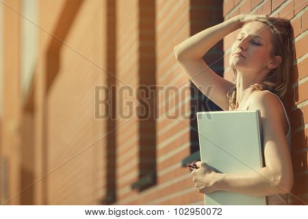 Beautiful Student With Laptop Relaxing Outside Library