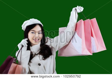 Woman In Winter Mantle Holds Shopping Bags