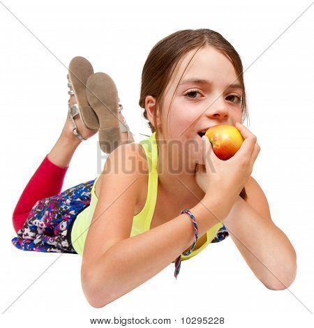 Primary Age Girl Eating An Apple