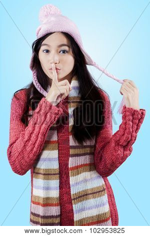 Young Girl Putting Finger On Lips