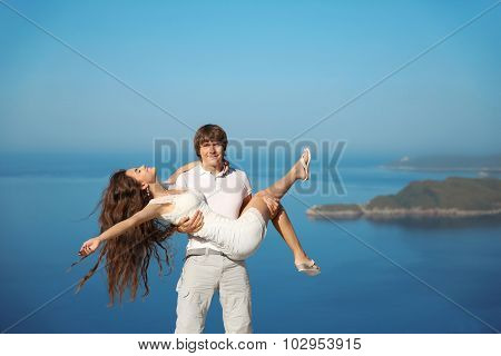 Happy Smiling Couple Having Fun Over Blue Sky Background. Enjoyment. Holidays, Vacation, Love And Ha