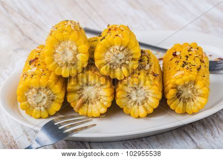 Roasted Sweet Corn On The Cob On White Plate