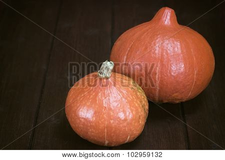 Two Pumpkins On The Wooden Table