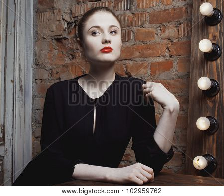 young stylish woman in make up room with mirror, diva actress before perfomance