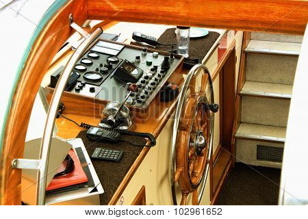 Yacht Interior With A Steering Wheel