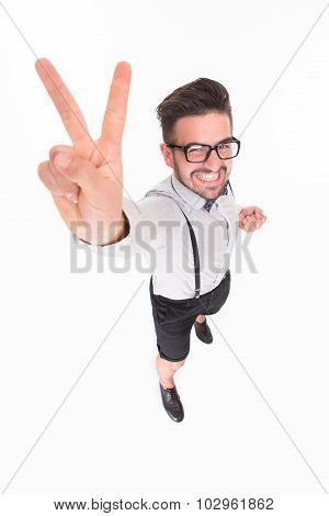 Handsome man showing okay sign in studio