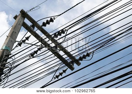 silhouette Electricity poles and wires and sky background