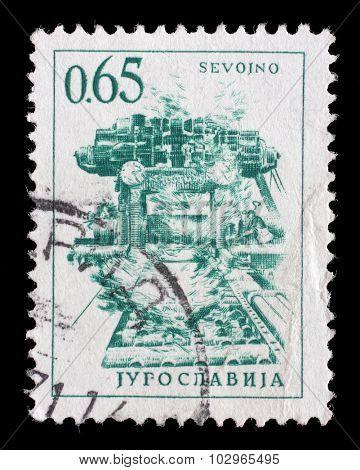 YUGOSLAVIA - CIRCA 1966: A stamp printed in Yugoslavia shows steel plant in Sevojno a local community in western Serbia, circa 1966