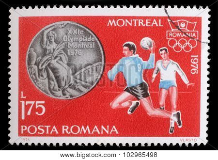 ROMANIA - CIRCA 1976: A stamp printed in Romania, shows Handball, and Olympic Rings, with inscription Montreal, 1976, circa 1976
