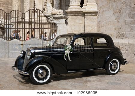 VALENCIA, SPAIN - SEPTEMBER 26, 2015: A Mercedes-Benz 170S parked in front of the Valencia Cathedral. The Mercedes-Benz 170S was a luxury four cylinder passenger car manufactured between 1949-1952.
