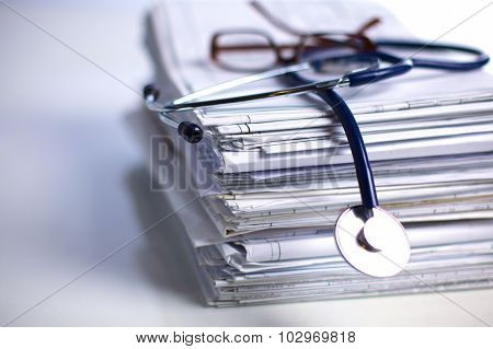 books folder file and stethoscope isolated on white background