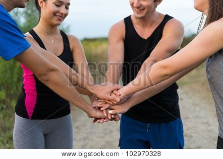 Young People Putting Hands Together For Motivation