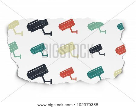 Safety concept: Cctv Camera icons on Torn Paper background