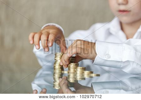 Little Boy Counting One Euro Column