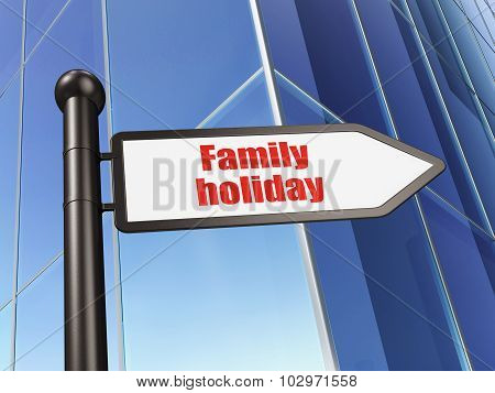 Travel concept: sign Family Holiday on Building background