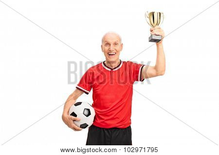 Delighted senior man in a football jersey holding a golden trophy and celebrating isolated on white background