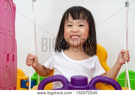 Asian Chinese Little Girl Playing On Swing