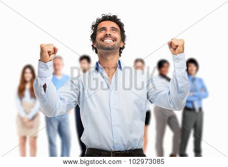 Portrait of a very happy man in front of a group of people