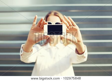 Woman Makes Self-portrait On The Smartphone In The City, View Of Screen
