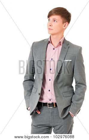 Successful young businessman in suit, isolated on white background