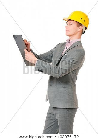 Young foreman with hard hat holding a clipboard, isolated on white background