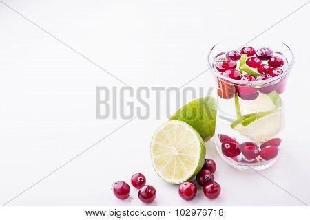 Cranberry lemon detox water in a glass jar.